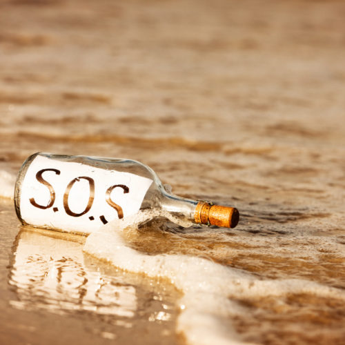 """""""A castaway's bottle lies washed up in the surf at water's edge, containing the urgent message SOS. Trouble is, there's nobody there to pick it up!"""""""