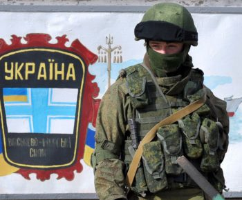 A member of the Russian forces stands gu...A member of the Russian forces stands guard by a Ukrainian Navy emblem painted on a wall outside the Ukrainian base in Perevalnoye, near Simferopol, blocked by Russian troops on March 6, 2014. Pro-Moscow authorities in Crimea on March 6 asked Russian President Vladimir Putin to examine a request for their region to join the Russian Federation, which will be put to a referendum on March 16. AFP PHOTO/ GENYA SAVILOVGENYA SAVILOV/AFP/Getty Images