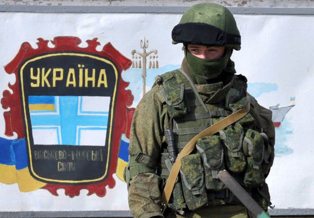 A member of the Russian forces stands gu…A member of the Russi