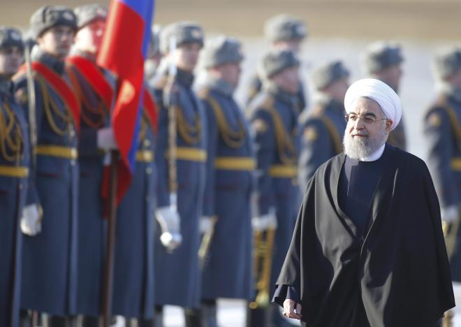Iranian President Rouhani inspects honour guard during welcoming ceremony upon his arrival at Vnukovo International Airport in Moscow