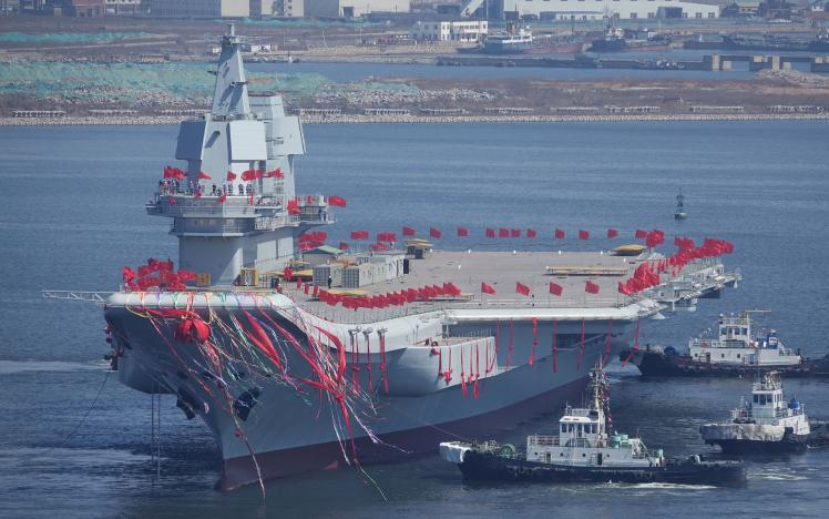 China's first domestically built aircraft carrier is seen during its launching ceremony in Dalian