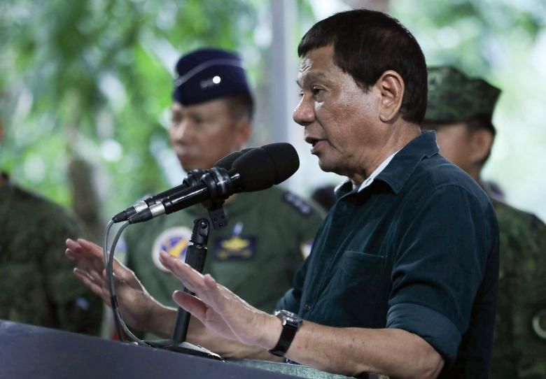 Philippine President Rodrigo Duterte speaks to soldiers during a visit at a military camp in Iligan