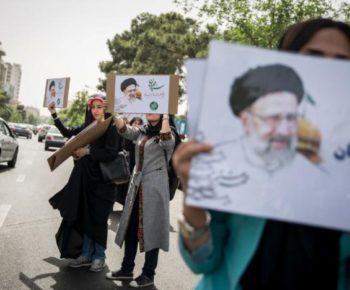 Supporters of Iranian presidential candidate Ebrahim Raisi hold his posters outside the Mosalla mosque in Tehran, Iran, May 16, 2017. REUTERS/TIMA