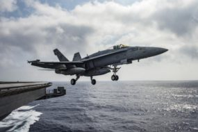 U.S. Navy F/A-18E Super Hornet launches from the flight deck of the aircraft carrier USS Dwight D. Eisenhower in the Mediterranean Sea