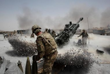 FILE PHOTO: U.S. Army soldiers from the 2nd Platoon, B battery 2-8 field artillery, fire a howitzer artillery piece at Seprwan Ghar forward fire base in Panjwai district