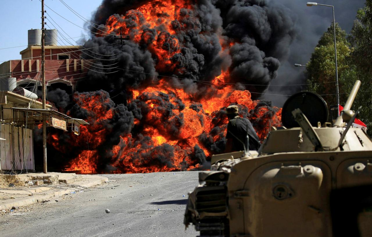 Smoke rises during clashes between joint troop of Iraqi army and Shi'ite Popular Mobilization Forces (PMF) against the Islamic State militants in Tal Afar
