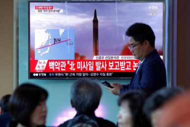 People watch a television broadcasting a news report on North Korea firing a missile that flew over Japan's northern Hokkaido far out into the Pacific Ocean, in Seoul