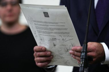 A declaration of independence is seen after it was signed by members of the Catalan regional government at the Catalan regional parliament in Barcelona