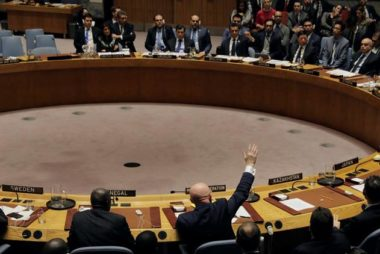 Russian Ambassador to the United Nations Nebenzya votes for a Russian resolution during a meeting of the U.N. Security Council in New York