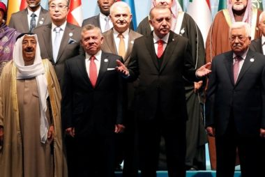Turkish President Erdogan poses with Emir of Kuwait Sabah Al-Ahmad Al-Jaber Al-Sabah, Jordan's King Abdullah and Palestinian President Abbas for a group photo during an extraordinary meeting of the OIC in Istanbul