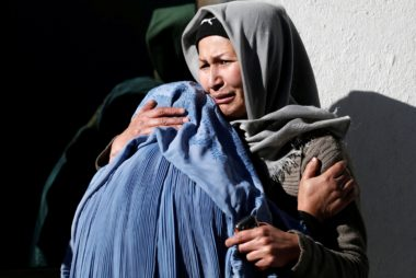 Image: Afghan women mourn inside a hospital compound after a suicide attack in Kabul, Afghanistan