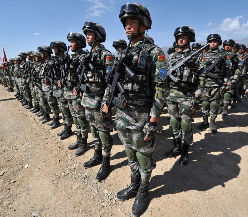 Chinese soldiers stand at attention during Peace Mission-2016 joint military exercises of the Shanghai Cooperation Organization (SCO) in the Edelweiss training area in Balykchy some 200 km from Bishkek on September 19, 2016.   The joint anti-terrorism drill involves more than 1,100 troops of Russia, Kazakhstan, Kyrgyzstan, Tajikistan, Uzbekistan and China as members of the Shanghai Cooperation Organization. / AFP / VYACHESLAV OSELEDKO        (Photo credit should read VYACHESLAV OSELEDKO/AFP/Getty Images)