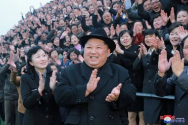 North Korean leader Kim Jong Un reacts as people applaud during his visit to the newly-remodeled Pyongyang Teacher Training College