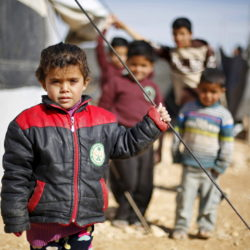 Syrian refugee children pose as they play near their families' residence at Al Zaatari refugee camp in the Jordanian city of Mafraq, near the border with Syria, January 30, 2016. REUTERS/ Muhammad Hamed - RTX24OMS