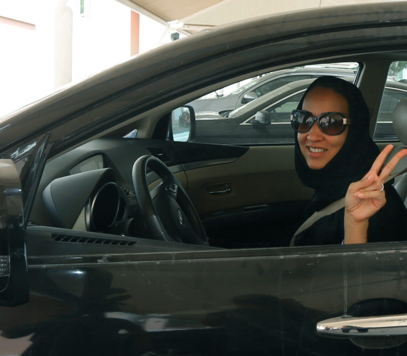 "TO GO WITH AFP STORY BY ACIL TABBARA  Saudi activist Manal Al Sharif, who now lives in Dubai, flashes the sign for victory as she drives her car in the Gulf Emirate city on October 22, 2013, in solidarity with Saudi women preparing to take to the wheel on October 26, defying the Saudi authorities, to campaign women's right to drive in Saudi Arabia. Under the slogan "" driving is a choice "", activists have called on social networks for women to gather in vehicles on October 26, the culmination of the campaign launched in September, in the only country in the world where women do not have the right drive. AFP PHOTO/MARWAN NAAMANI        (Photo credit should read MARWAN NAAMANI/AFP/Getty Images)"