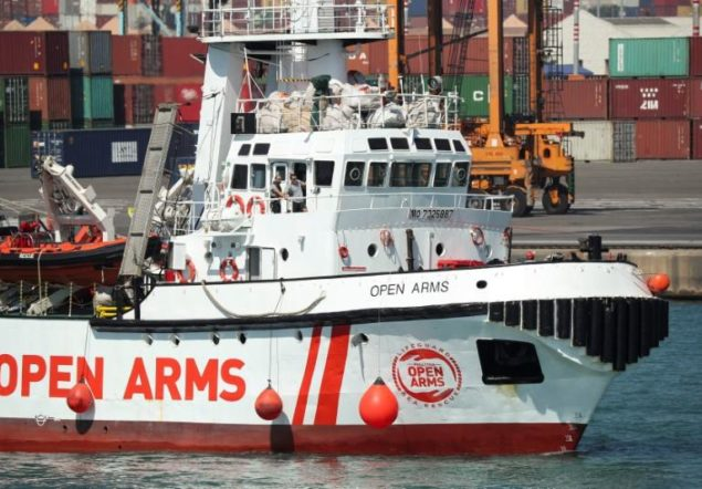 The Open Arms rescue boat run by the Spanish Proactiva Open Arms charity, arrives to port in Barcelona