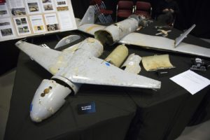 FILE - In this Dec. 14, 2017 file photo, the remains of an Iranian Qasef-1 Unmanned Aerial Vehicle, used as a one-way attack to dive on targets and then detonating its warhead, which was fired by Yemen into Saudi Arabia, according to then-U.S. Ambassador to the U.N. Nikki Haley, is seen during a press briefing at Joint Base Anacostia-Bolling in Washington. Saudi Arabia said drones attacked one of its oil pipelines as other assaults targeted energy infrastructure elsewhere in the kingdom on Tuesday, May, 14, 2019, shortly after Yemen's rebels claimed a coordinated drone attack on the Sunni power. (AP Photo/Cliff Owen, File)