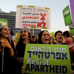 Israeli Arabs and their supporters take part in a rally to protest against Jewish nation-state law in Rabin square in Tel Aviv, Israel August 11, 2018. REUTERS/Ammar Awad