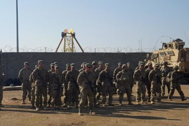 FILE PHOTO: U.S. soldiers gather at a military base north of Mosul