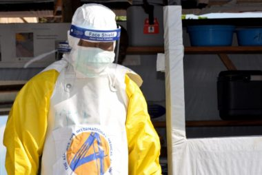 FILE PHOTO: A medical worker wears a protective suit as he prepares to administer Ebola patient care at The Alliance for International Medical Action (ALIMA) treatment center in Beni