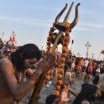 Allahabad: Naga Sadhus take holy dip on auspicious Makar Sankranti day during the Kumbh Mela, or pitcher festival in Allahabad, Uttar Pradesh, Tuesday, Jan.15, 2018. (PTI Photo/Ravi Choudhary)(PTI1_15_2019_000001B)