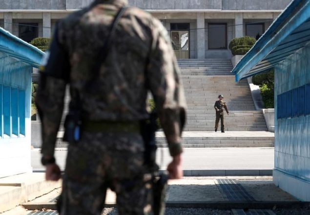 A North Korean soldier patrols at the truce village of Panmunjom
