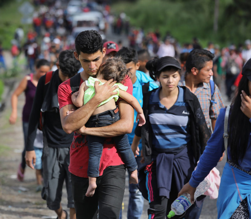 ESQUIPULAS, GUATEMALA - OCTOBER 15:  A caravan of more than 1,500 Honduran migrants moves north after crossing the border from Honduras into Guatemala on October 15, 2018 in Esquipulas, Guatemala. The caravan, the second of 2018, began Friday in San Pedro Sula, Honduras with plans to march north through Guatemala and Mexico en route to the United States. Honduras has some of the highest crime and poverty rates in Latin America.  (Photo by John Moore/Getty Images)