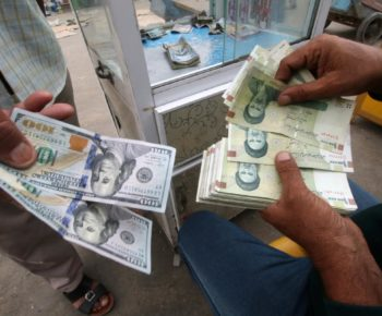 Iranian rials, U.S. dollars and Iraqi dinars are seen at a currency exchange shop in Basra, Iraq November 3, 2018. Picture taken November 3, 2018. REUTERS/Essam al-Sudani