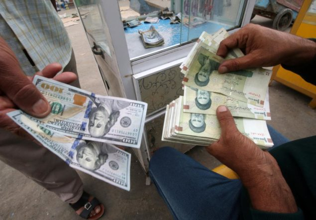 Iranian rials, U.S. dollars and Iraqi dinars are seen at a currency exchange shopÊin Basra