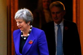 Britain's Prime Minister Theresa May and Chancellor of the Exchequer Philip Hammond leave 10 Downing Street, in London