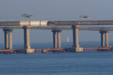 Russian jet fighters fly over a bridge connecting the Russian mainland with the Crimean Peninsula after three Ukrainian navy vessels were stopped by Russia from entering the Sea of Azov via the Kerch Strait in the Black Sea