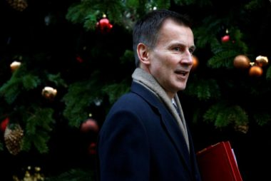 FILE PHOTO: Britain's Secretary of State for Health, Jeremy Hunt arrives in Downing Street, London