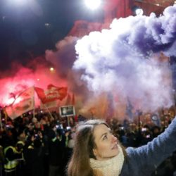 """Anna Donath, Vice President of the opposition party Momentum Movement, holds a flare during a protest against a proposed new labor law, billed as the """"slave law"""", in Budapest, Hungary, December 16, 2018. REUTERS/Bernadett Szabo"""