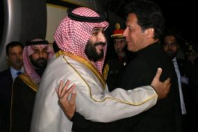 Pakistani Prime Minister Imran Khan greets Saudi Arabia's Crown Prince Mohammed bin Salman on his arrival at Pakistan Air Force Nur Khan Base in Rawalpindi