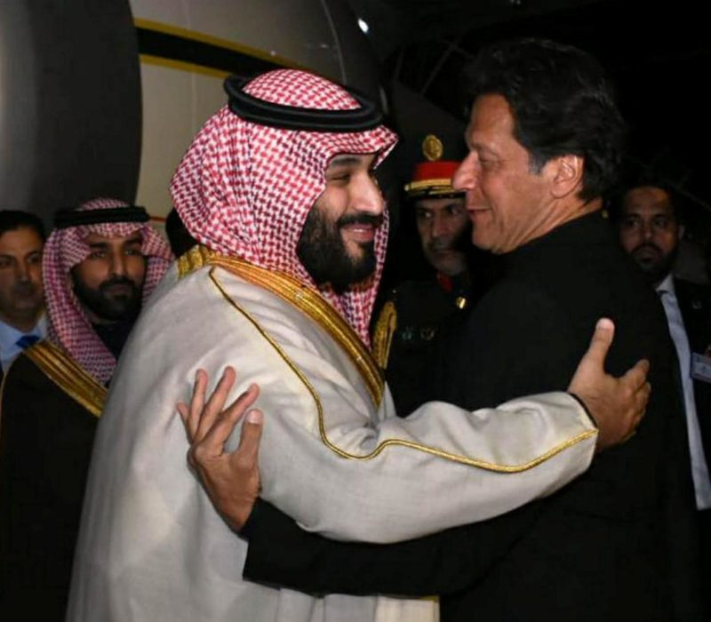 Pakistani Prime Minister Imran Khan (R) greets Saudi Arabia's Crown Prince Mohammed bin Salman on his arrival at Pakistan Air Force (PAF) Nur Khan Base in Rawalpindi, Pakistan February 17, 2019. Press Information Department (PID)/Handout via REUTERS