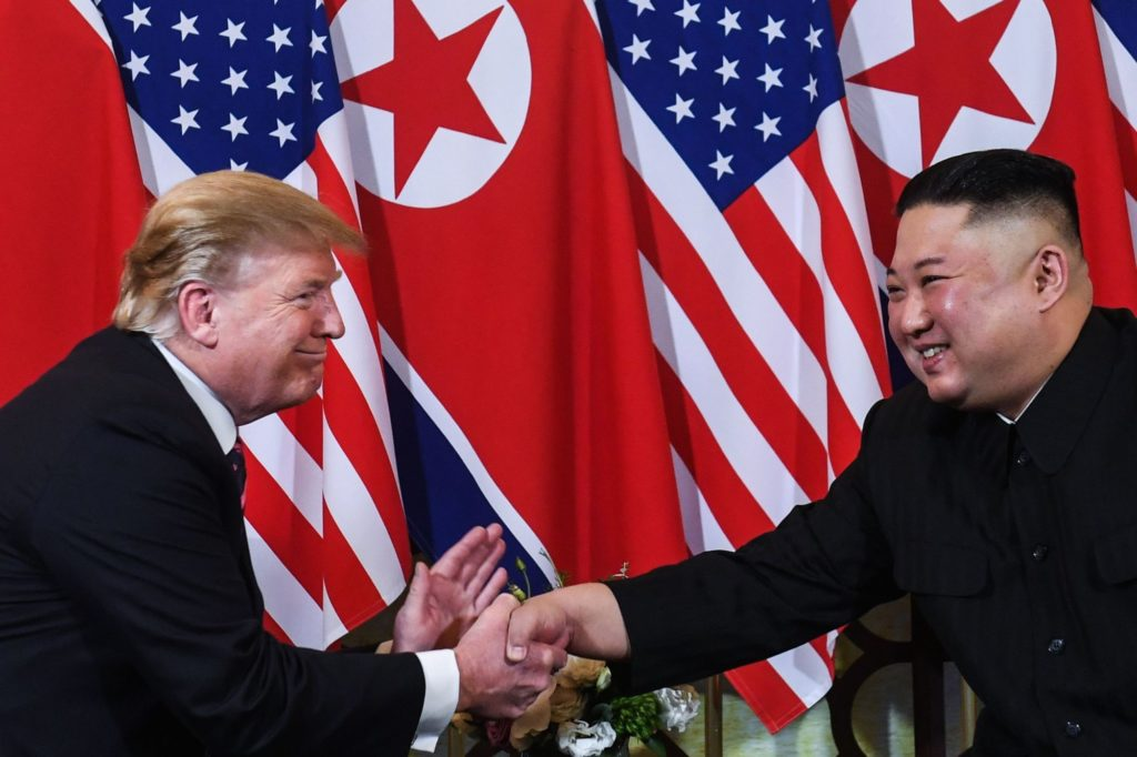 TOPSHOT - US President Donald Trump (L) shakes hands with North Korea's leader Kim Jong Un following a meeting at the Sofitel Legend Metropole hotel in Hanoi on February 27, 2019. (Photo by Saul LOEB / AFP)