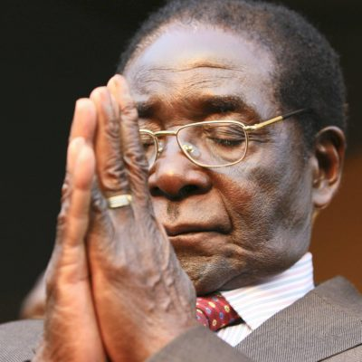 FILE - In this Wednesday, Aug. 29, 2007 file photo President Robert Mugabe is seen at the Zanu PF headquarters in Harare. Zimbabwe's Parliament erupted in cheers Tuesday Nov. 21, 2017 after the speaker announced the resignation of President Robert Mugabe after 37 years in power. (AP Photo/Tsvangirayi Mukwazhi, File)