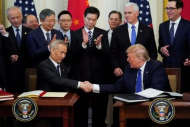 FILE PHOTO: Chinese Vice Premier Liu He and U.S. President Donald Trump shake hands after signing a Phase 1 U.S.-China trade agreement at the White House