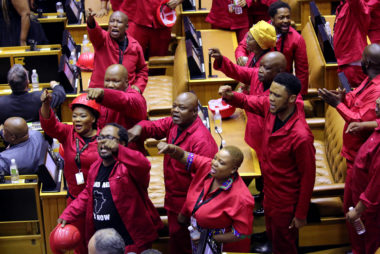 Members of the opposition Economic Freedom Fighters (EFF) party object as South African President Cyril Ramaphosa attempts to deliver his State of the Nation address at parliament in Cape Town