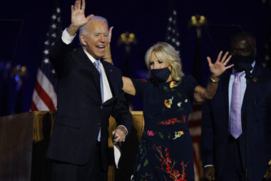 Democratic 2020 U.S. presidential nominee Joe Biden celebrates onstage at his election rally in Wilmington